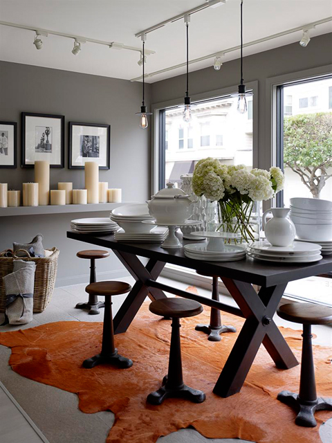 Cowhide rugs, European tableware and chunky candles.